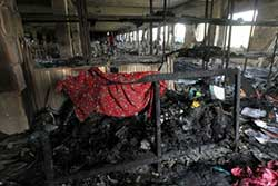 Bangladesh arrests fire factory