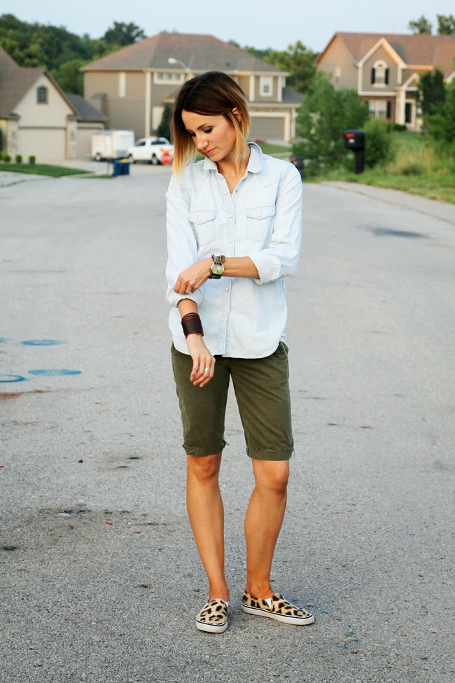 Light denim shirt, olive cut offs, leopard sneakers
