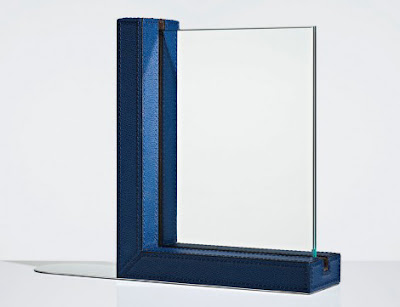 leather bookend, blue, that holds a photograph