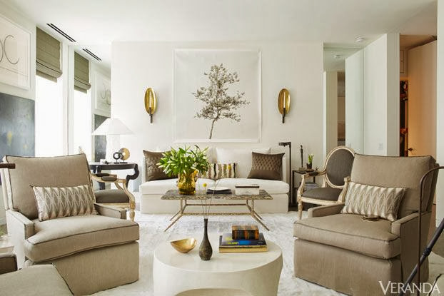 large white living room with gold accents beige neutral furniture