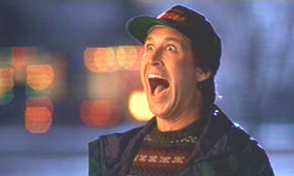Chevy Chase delighted Christmas Vacation 1989 movieloversreviews.blogspot.com