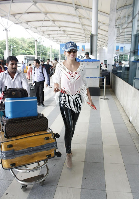 Urvashi Rautela Looks Super Sexy In a Black Tatex Trouser and White See-through Top At Domestic Airport