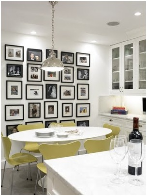 Modern white kitchen and decorated with pictures in the wall