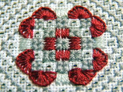 Close-up of center motif - squares edged with buttonhole stitching