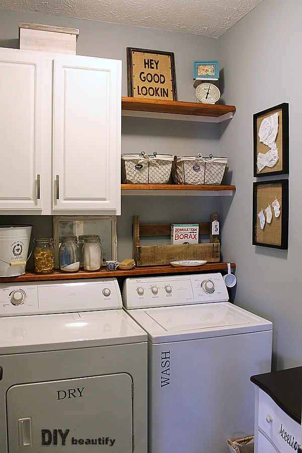 Farmhouse modern laundry room reveal diy beautify for Laundry room shelving