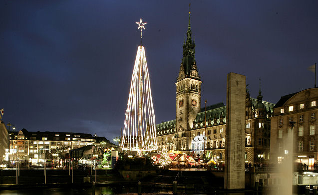 Hamburg Christmas market sparkles beneath its towering Christmas tree and the Rathaus or town hall rising in the background. Photo: Courtesy of German Christmas Market.Org.UK. Unauthorized use is prohibited.