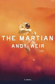 Cover description: The Martian by Andy Weir. An astronaut floating in the middle of red clouds and what looks like Mars' surface.