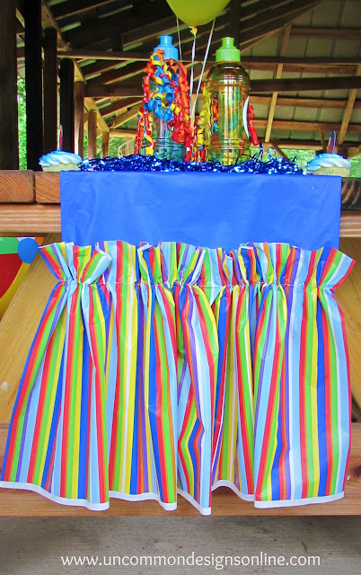 ruffled tablerunner from plastic tablecloths #partyideas #partydecor