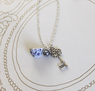http://folksy.com/items/4986192-Teacup-necklace-Alice-in-Wonderland-
