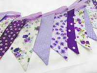 The sequence of purple and lilac fabrics selected for the bunting.