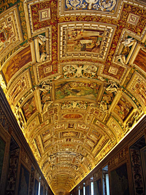 elaborately decorated fresco ceiling panel at the sistine chapel
