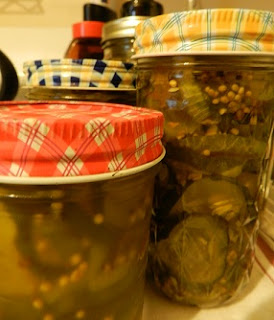 bread and butter pickles in glass canning jars with colorful lids