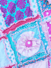 Close up of Ruffle Flowers on Crib Quilt for Baby Girl