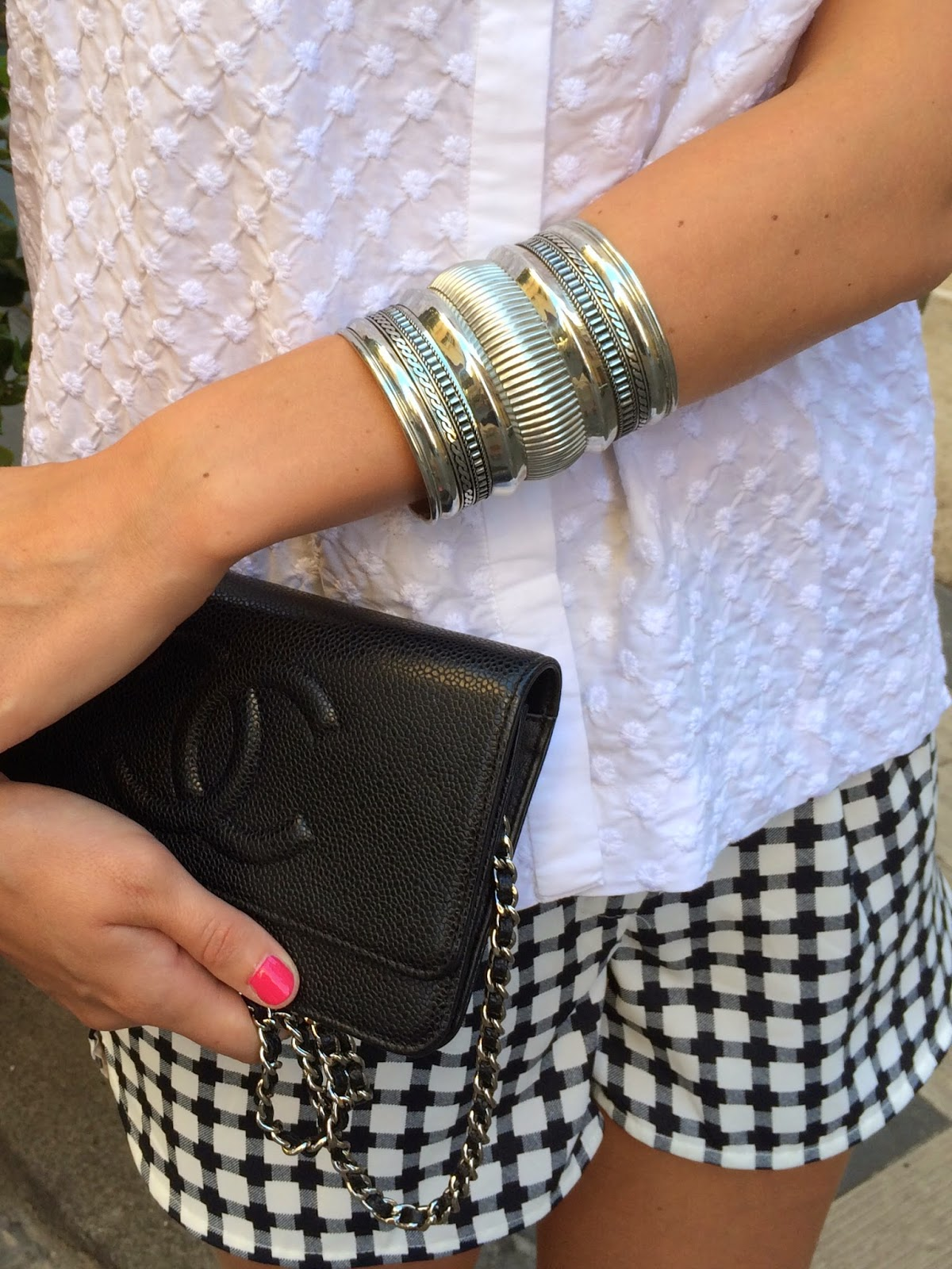 silver cuff, silver bracelet, chanel clutch, wallet on chain, chanel bag, zara shorts, gap shirt, white shirt, pink nails, pink nail polish, dior nail polish, dior plaza nail polish, checked shorts