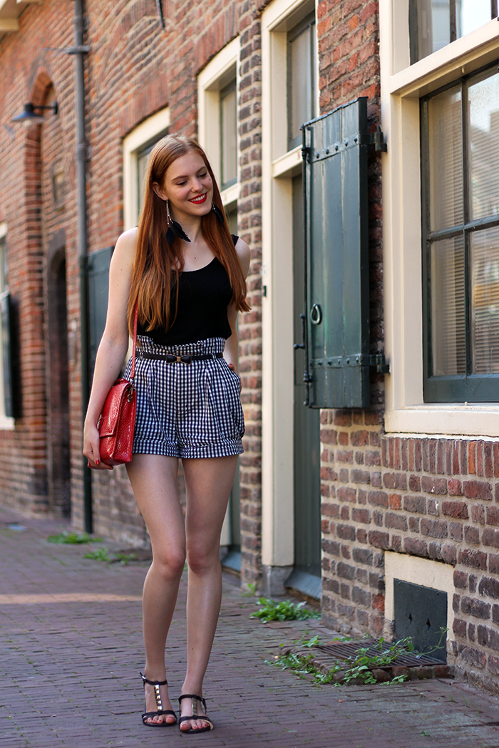 Red Sonja Vintage Fashion Blog Outfit with Gingham Shorts Bow Belt Feather Earrings and Sandals