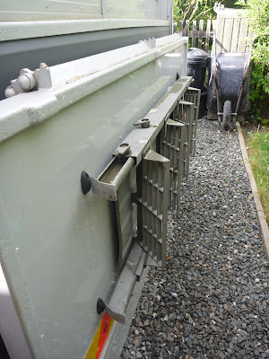 "small rubber ""mouse"" blocks used to stop the steps scratching the tail-lift cover when talking them on and off."