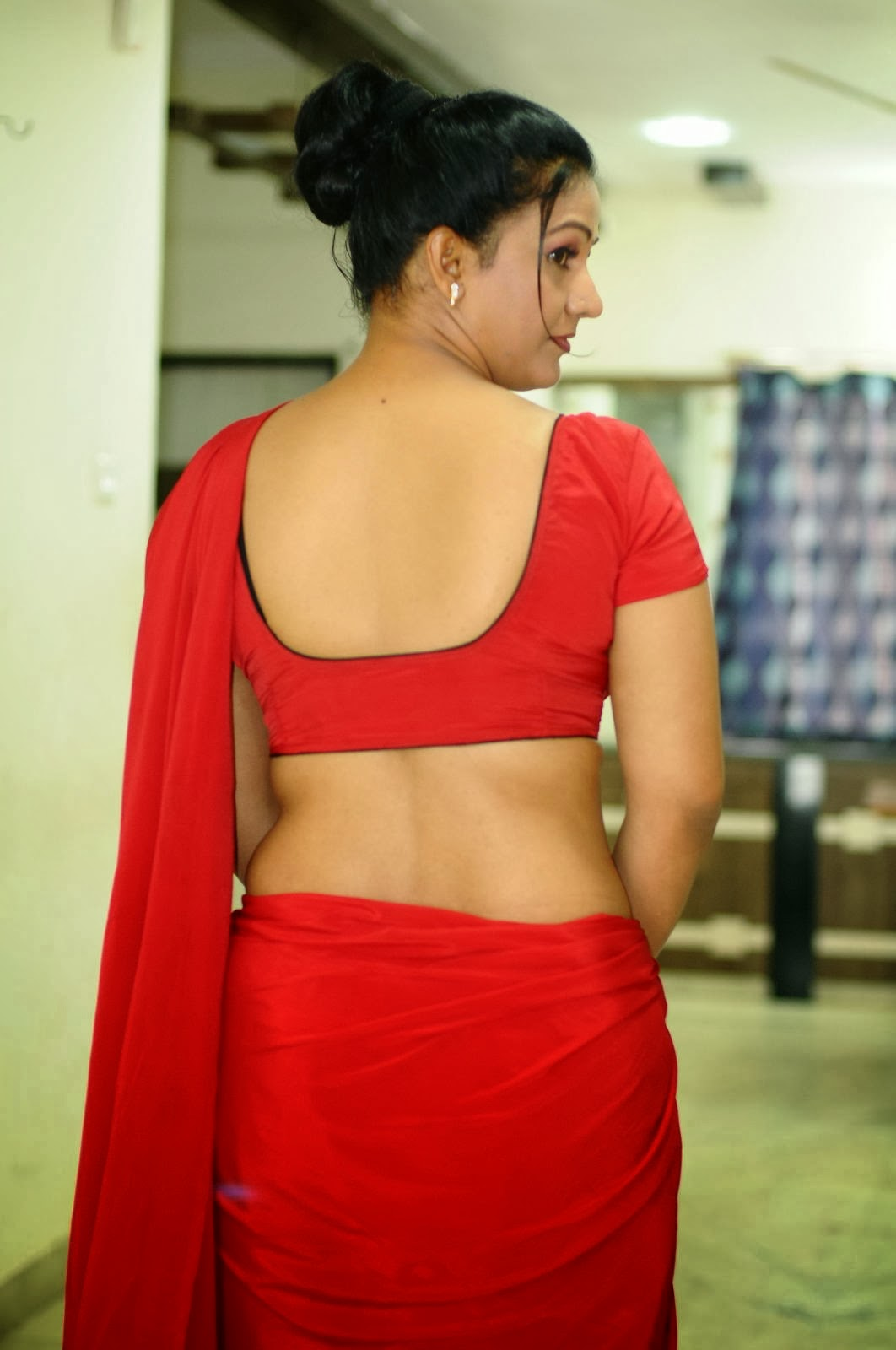 Actress Apoorva Hot Navel Show in Red Saree Photo Gallery