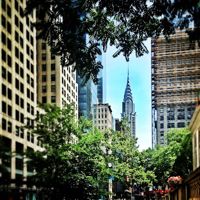 Chrysler building from Bryant Park in New York City in the summer