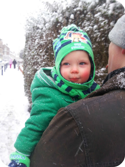 first walk in the snow, toddler in the snow