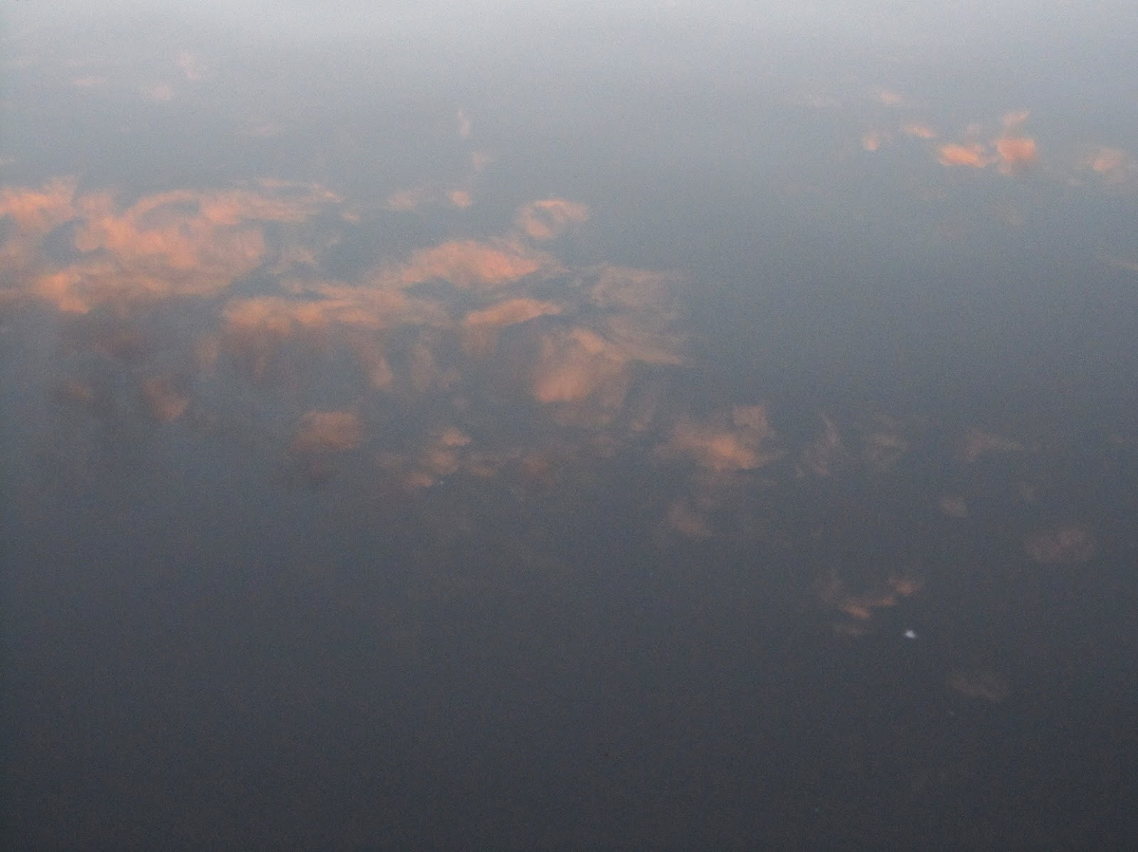 reflection of pink clouds in water