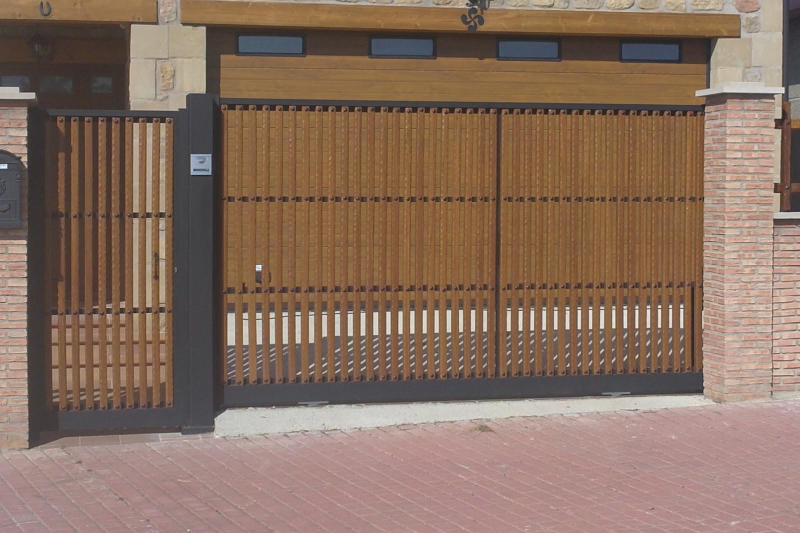 Talleres montiel puerta corredera y peatonal en unifamiliar for Puerta corredera de taller