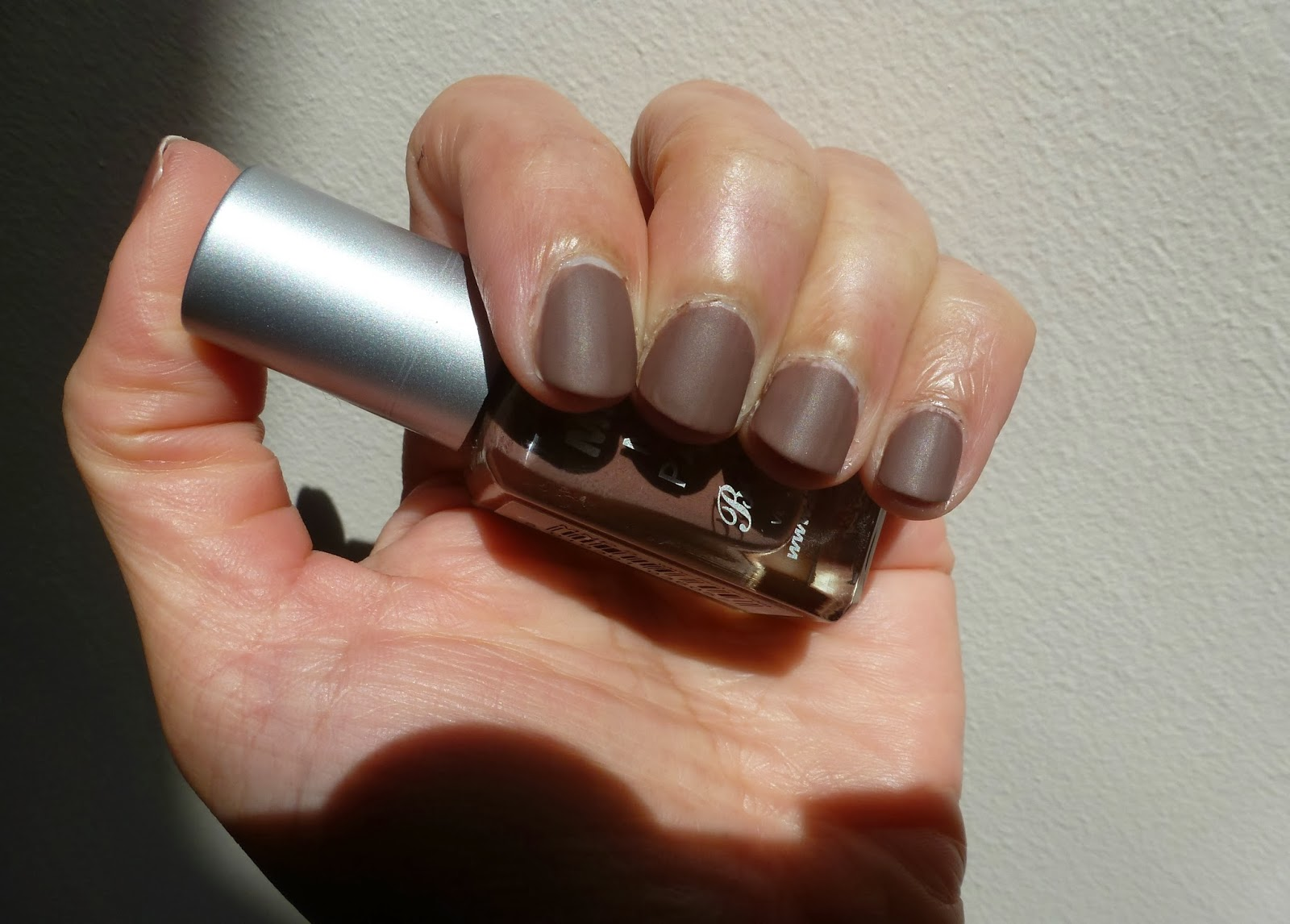 A picture of Barry M Matte Nail Paint in Mocha with No7 Matte Topcoat