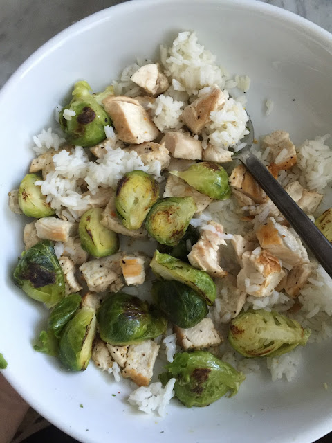 Chicken, rice and roasted brussel sprouts.