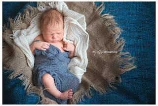 newborn  photo with newborn with blue blanket