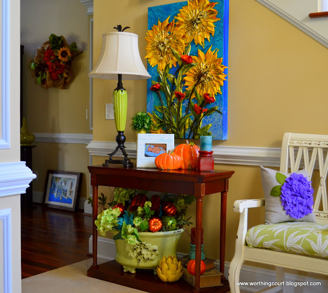 Fall vignette on a table in the foyer via Worthing Court blog