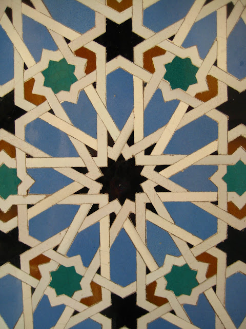 Mosaic tile wall in The Alcazar, or Royal Palace in Seville, Spain.