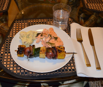 Salmon with grilled vegetable skewer and potato salad