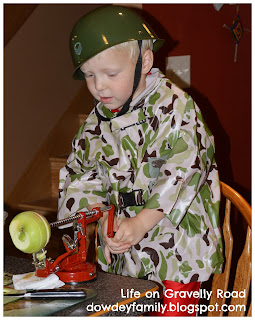boy in costume using apples slicer