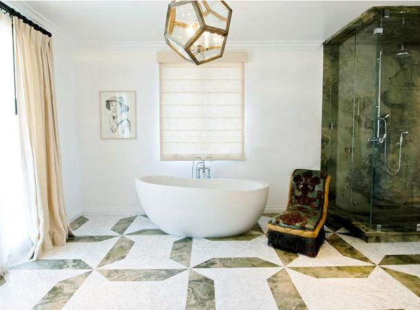 bathroom with stand alone tub, a large window with floor length curtains, tile floor and a dodecahedron light
