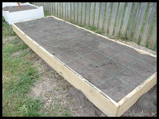 newly constructed square foot garden bed