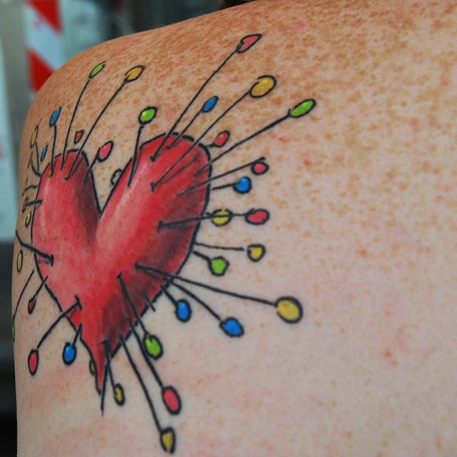 Voodoo Girl heart tattoo on shoulder