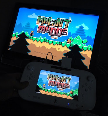 Mutant Mudds Deluxe title screen on TV and Wii U GamePad