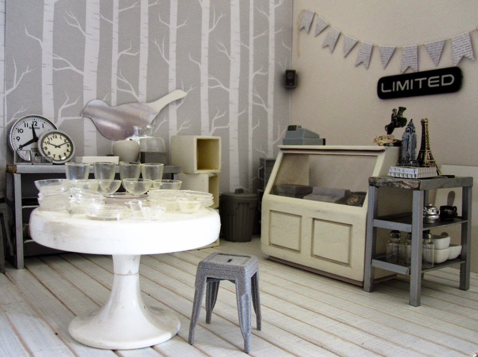 A modern dolls' house miniature homeware shop in grey and white.