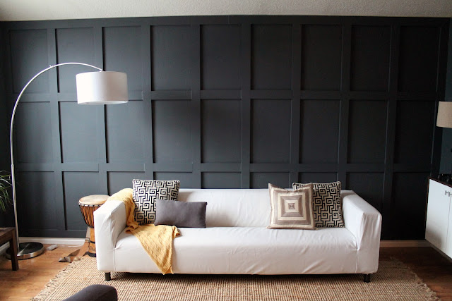 Chris Loves Julia DIY black paneled wall living room
