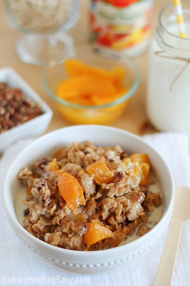 Check out this incredibly easy and healthy Slow Cooker Peach Oatmeal recipe! Breakfast in the crock pot!