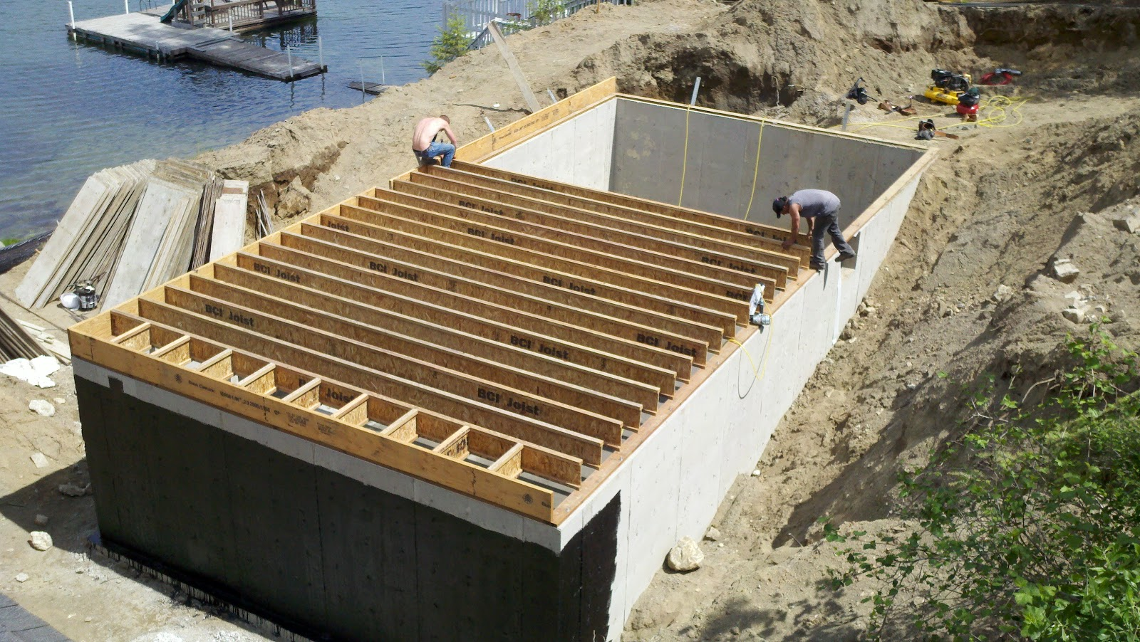 Tanner lake place footings for the basement storage Floor trusses vs floor joists