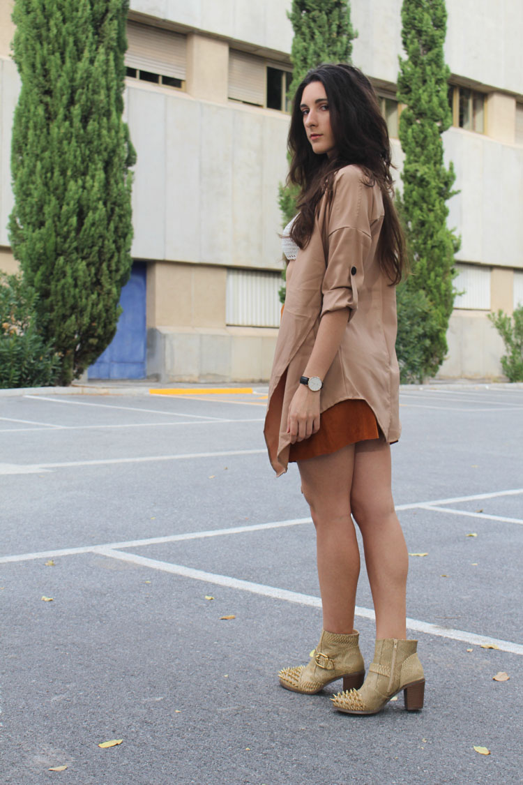 Suede skirt, camel trench, spiked boots, silver necklace, knit bikini