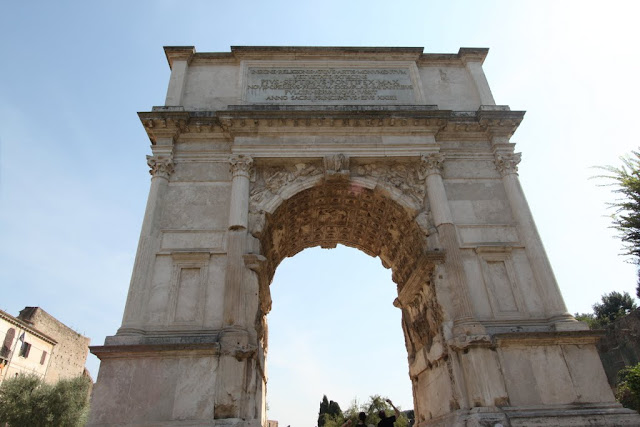 Arch of Titus on the other side at Roman Forum in Rome, Italy