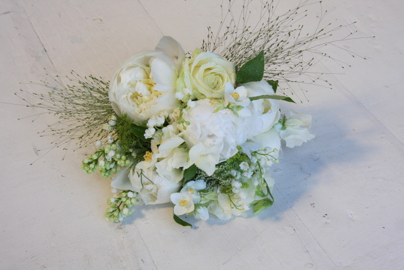A Beautiful white wedding bouquet of Fresh Fragrant Lily of the Valley