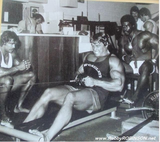 "ROBBY ROBINSON, DENNY GABLE, ARNOLD SCHWARZENEGGER - PHOTO  SHOOT DURING TRAINING AND FILMING OF 'PUMPING IRON' AT GOLD'S  GYM VENICE, 1975  -- Read about RR's training and life experience, about other  legends of Golden Era of bodybuilding and what really happened behind the scenes  of Weider's empire - in RR's BOOK ""The BLACK PRINCE;  My Life in Bodybuilding: Muscle vs. Hustle"" ● www.robbyrobinson.net/books.php ●"