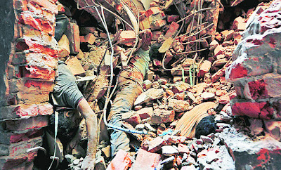 Corpses trapped in debris of Rana Plaza building, Dhaka, Bangladesh