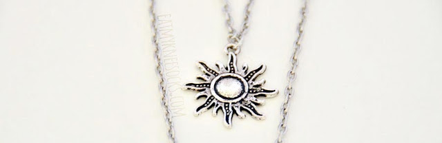 Close-up on the sculpted star pendant on the silver 3-tier layered necklace from Born Pretty Store.