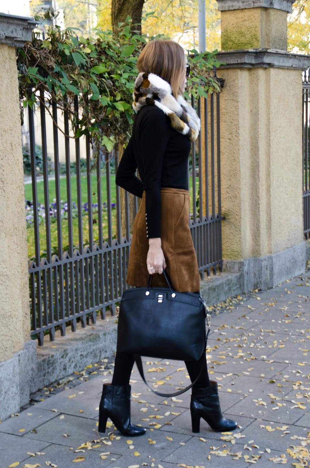 kristjaana mere suede skirt black turtleneck fur scarf furla black bag fall fashion