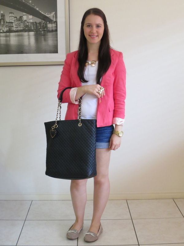 dark wash denim shorts, a white t-shirt, coral blazer and gold jewellery