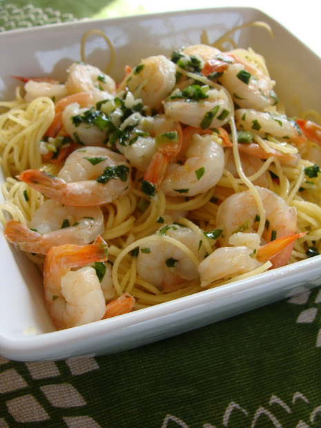 cooking shrimp scampi over
