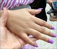 finger nails painted purple